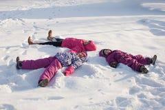 Three angels on the snow Stock Image