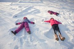 Three angels on the snow Royalty Free Stock Image