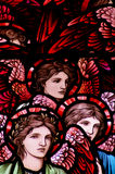 Three angels in stained glass Stock Photo