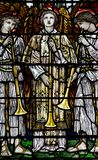 Three angles with trumpets in stained glass. A photo of Three angles with trumpets in stained glass stock images