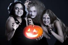 Three angry ghost with orange pumpkin Stock Photo