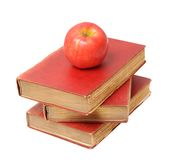 Three antique books and apple Stock Image