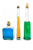 Three antique bottles with colorful liquids Royalty Free Stock Photos