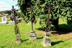 Three antique christian metal crosses used as headstones Royalty Free Stock Images