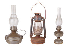 Three antique kerosene lamps isolated on white background Stock Image