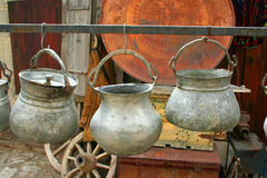 Three antique pots hanging Royalty Free Stock Photos