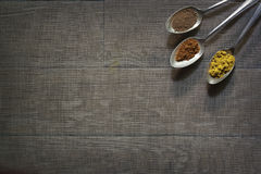 Three Antique Silver Spoons with Different Spices in Each Royalty Free Stock Photography