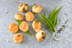 Pull apart bread roll. Three apart bread roll with ramsons and herbs royalty free stock photography
