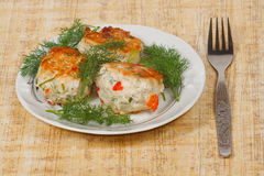 The three appetite cutlets with greens. The three appetite cutlets with fresh greens Stock Photo