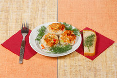 The three appetite cutlets with greens. The three appetite cutlets with fresh greens and bread Royalty Free Stock Photo