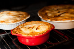 Three apple pies cooking Stock Image