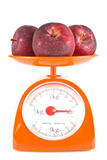 Three apples. Lying on weight scale Stock Photo