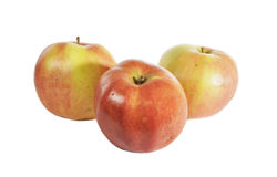 Three apples. Lie on a table Royalty Free Stock Photography