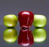 Three apples. On gray background Royalty Free Stock Photography