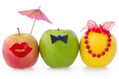 Three apples as a concept of competition. Between two female and one male Stock Image