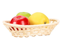Three apples in basket Royalty Free Stock Photography