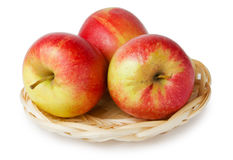 Three apples in a basket Royalty Free Stock Photography