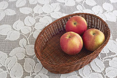 Three apples in a basket Stock Photos