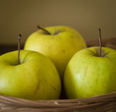Three apples in the basket Royalty Free Stock Photo