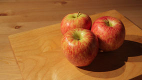 Three apples on a cutting board stock footage