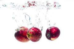 Three apples fall deeply under water Royalty Free Stock Image