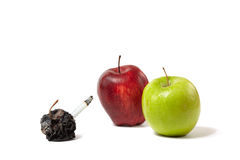 Three apples: fresh, rotting and dead Stock Photo