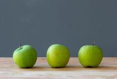 Three apples fruit on table Royalty Free Stock Photo