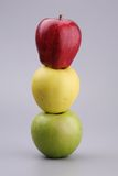 Three apples on a grey background Stock Photography