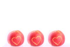 Three apples with heart Stock Photo