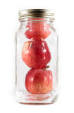 Three Apples In A Glass Mason Jar For Canning Stock Image