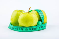 Three apples and meter Royalty Free Stock Photography