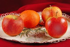 Three apples and one orange Royalty Free Stock Images