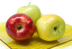 Three apples in a plate Royalty Free Stock Photo