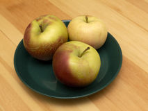 Three apples on the plate Stock Photography