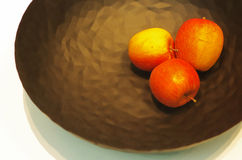 Three apples in a plate Royalty Free Stock Image