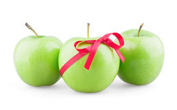 Three apples with ribbon. On white background royalty free stock photography