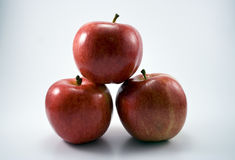 Three Apples Stacked Stock Photography