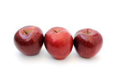 Three apples standing in a row Stock Images