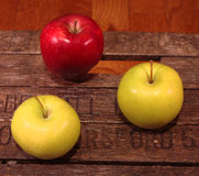 Three apples on a vintage case Royalty Free Stock Images