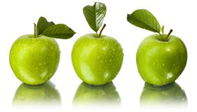 Three apples with water drops Royalty Free Stock Photo