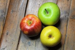 Three apples on wooden background Stock Photo