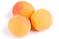 Three apricots royalty free stock photos