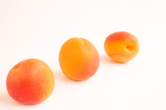 Three Apricots in Diagonal Line Stock Images