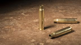 Three empty AR-15 rounds on the floor Royalty Free Stock Image