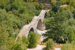 Three-Arch Old Stone Bridge. An old stone bridge (called Kalogeriko) with three arches, made for the pedestrians and mules of the old times (Kipi village, Zagori Royalty Free Stock Photos