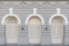 Three arched doors in historic buildings Stock Images