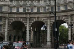 The three arches of Admiralty Arch at The Mall in London, England. Admiralty Arch at the end of The Mall in London, England, with traffic passing under. Built Stock Photos