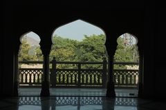 Three Arches on pillars and balcony. One large and two small royal arches set on columns with open space stock photography