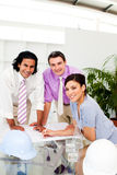 Three architect co-workers studying plans royalty free stock photos