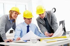 Three architects Royalty Free Stock Image